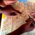 Hands examining a map